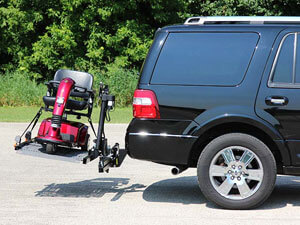 SUV with wheelchair lift installed on back holding red scooter