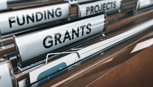 file folders with Funding and Grants labels