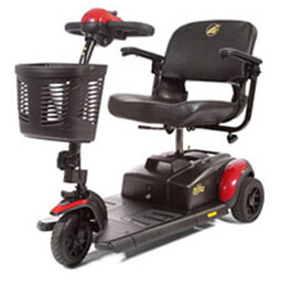 red 3 wheel Buzzaround LT electric mobility scooter with basket