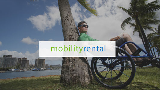 mobility rental - man in wheelchair leaning against tree