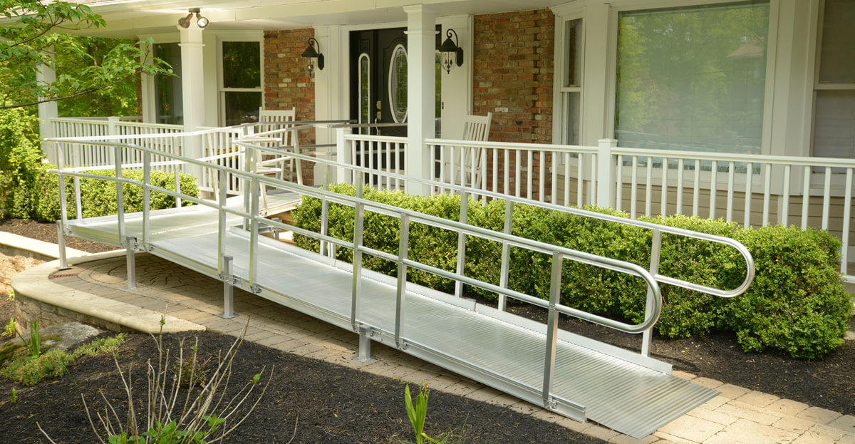 wheelchair ramp coming from front porch of a house